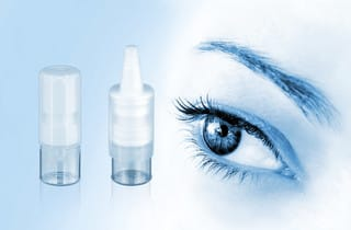 Aero Pump's Ophthalmic Dropper system, shown next to a woman's eye.<br>